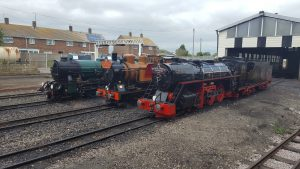 Southern Maid, The Bug & Black Prince wearing headboards commemorating 90 years of the RH&DR at New Romney July 2017