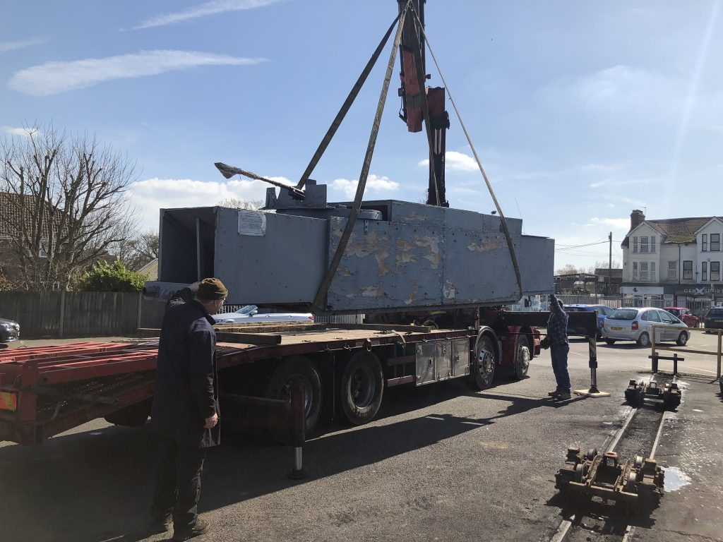 The armoured wagon leaves New Romney for the specialist rebuilders' works